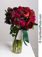 Bouquet of red peonies.