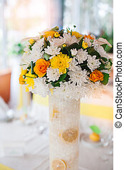 Flower arrangement for the wedding table yellow