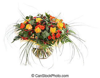 Flower arrangement of orange roses, hypericum and fern. Floral composition in a transparent glass vase. Isolated on white.