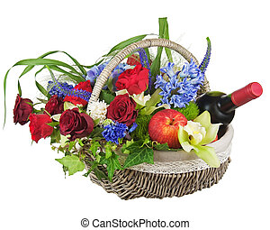 Flower arrangement of roses, orchids, fruits and bottle of wine isolated on white background.