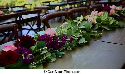 Flower arrangement on a table for wedding party in southern...