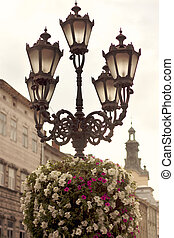 Flower arrangement on street lamp in Lvov - Flower...