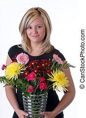Young Woman Holding A Floral Arrangement