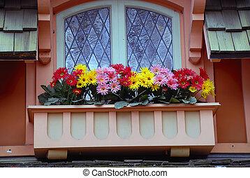 Beautiful flowers at an italian balcony window