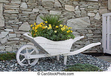 Flower bed pushcart in front of a house