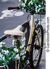 Flower bike on the side of the road