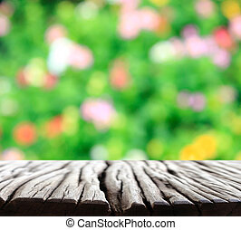 flower bokeh in blurred background with wood floor