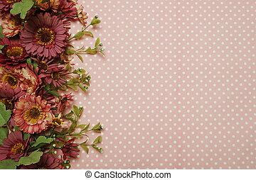 Flower border with pink polka dot background
