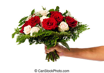 Flower bouquet - A womans hand is holding a bouquet of...