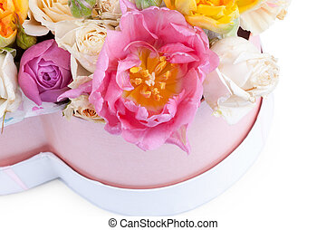 Flower bouquet in a heart shaped box isolated on white