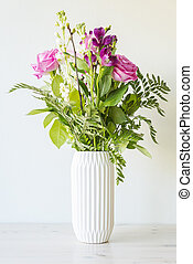 Flower bouquet in white vase