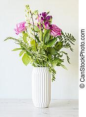 Flower bouquet in white vase