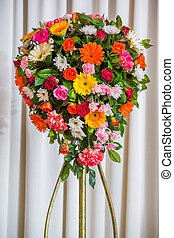 Flower bouquet isolated on white curtain in party room
