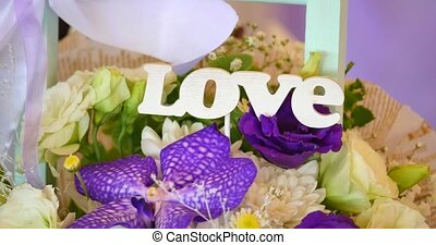 Flower bouquet with word love