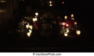 flower, candle light on tombstone in cemetery on dark. 4K -...