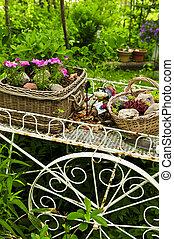 Flower cart in garden - Flower cart with two baskets in...