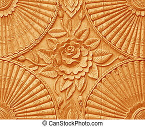 Flower carved on wood panels.