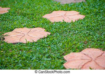 Flower cement block in lawn