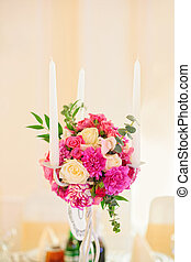 Flower composition with candles