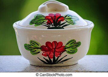 Cup with a pattern of red flowers.