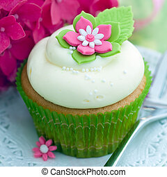 Flower cupcake - Cupcake decorated with a pink and white...