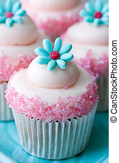 Flower cupcakes - Cupcakes decorated with pink frosting and...