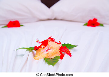 Flower decoration on the bed in a hotel