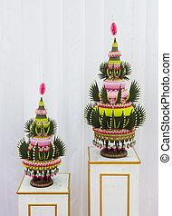 Flower decorations on pedestal trays in Thai traditional wedding ceremony