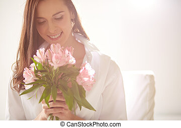 Flower delight - Portrait of lovely lady looking at bunch of...