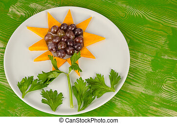 Flower dessert - Mango slices and grapes served as a...