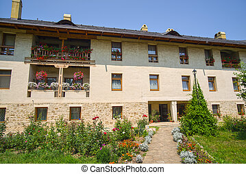 Flower garden and traditional monastery