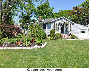 Suburban Home Flower Garden Landscaped Lawn Sunny Blue Sky Day