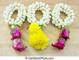 flower garland on wood floor