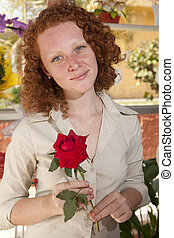 Woman holding a single rose
