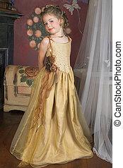 Flower Girl - Blond Flower girl wearing a golden dress with ...