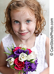 Flower Girl - Cute flower girl holding a small bouquet of...