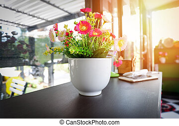 flower in cup / colorful of flower in white pot on wooden table
