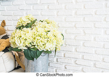 flower in pot with white brick wall background