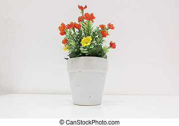 Flower in the white vase on the white table