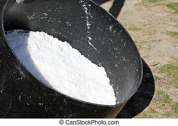 Flower of salt of Noirmoutier in bucket (France)