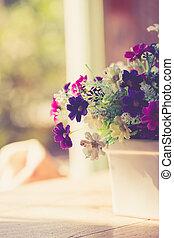 Flower on wood table, Vintage color