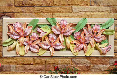 Flower orchid sculpture on a wall