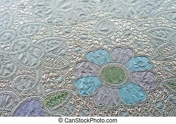 Flower pattern plastic tablecloth.