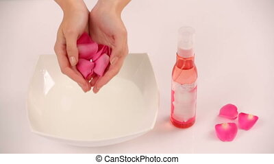 Flower petals - Throwing flower petals into a bowl of water....
