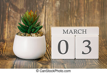 Flower pot and calendar for the snow season from 03 March. Spring time.