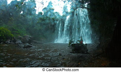 Flower Pot Hanging from Trees beneath Phnom Kulen Waterfall with Sound