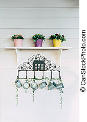 flower pot with equipment on the wall