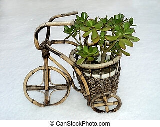 Flower pots in the form of a bike in snow