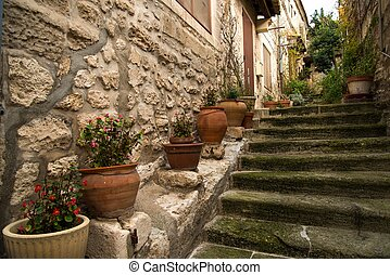 Flower pots on narrow medieval street