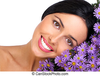 Pretty smiling woman with lovely fresh flowers